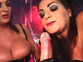 2 Kinky whores rides a masked sub with a strapon head dildo