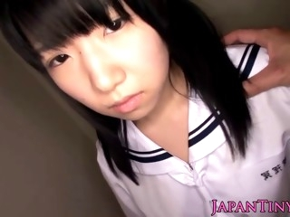 Petite Japanese schoolgirl's shaved little pussy toy stimulated
