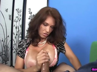 POV milf tugging hard cock on her knees